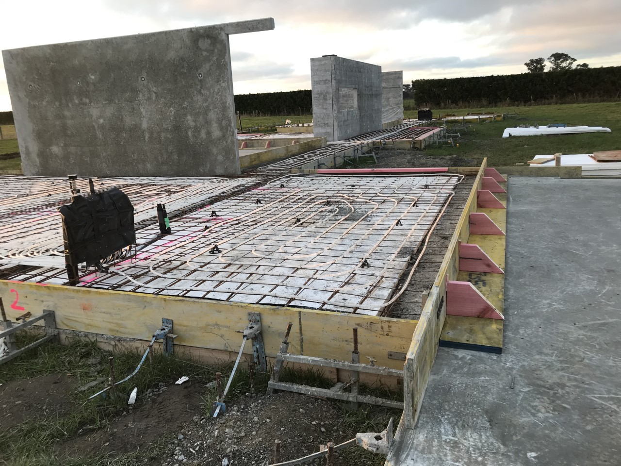 under floor heating being laid on top of concrete slab for a home